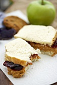 Partially Eaten Peanut Butter and Jelly Sandwich on White Bread, Bagged Lunch