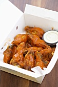 Spicy Buffalo Wings in a Take Out Box with Dressing, From Above