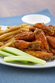 Spicy Buffalo Wings with Celery Sticks and French Fries