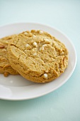 Two White Chocolate Chip Cookies with Almonds on a Plate