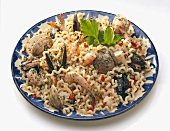Large Plate of Pasta with Assorted Shellfish on a White Background