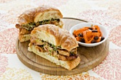 Chicken and Sprout Sandwich on a Croissant, Carrot and Raisin Salad