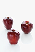 Three Red Delicious Apples on a White Background