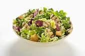 Bowl of Grilled Chicken Caesar Salad with Mixed Greens, White Background