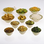 Many Bowls of Assorted Asian Dishes, White Background