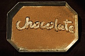 The Word Chocolate Written in Cocoa Powder, From Above