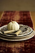 Small White Pumpkin on a Stacked Place Setting