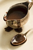 Chocolate Sauce in a Metal Pitcher, Spoon, From Above