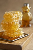 Honey Dripping From Stacked Honey Comb, Honey Bear Bottle