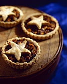 Three Mince Tartlets with Star Shaped Top Crusts