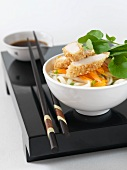 Udon noodles with sesame-coated chicken & carrot matchsticks