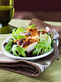 Grilled chicken breast on mizuna salad with lime