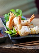 Deep-fried shrimps in batter with black sesame seeds