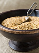 Uncooked brown rice in a wooden bowl