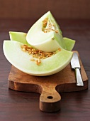 Three wedges of honeydew melon