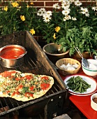 Grilled Pizza; On the Grill with Ingredients