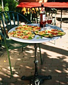 Outdoor Table with Corn, Tomato and Basil Pizza; Red Wine
