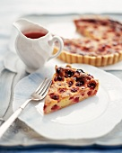 Slice of a Berry Torte on a Plate; Whole Torte