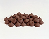 Pile of Chocolate Chips on a White Background