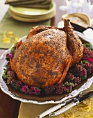 Herbed Roast Turkey on a Platter with Champagne Grapes