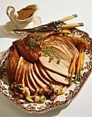 Sliced Roast Turkey on a Platter; Gravy Boat