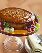 Glazed Spice Cake on a Pedestal with Grapes