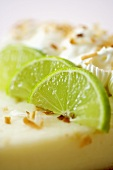 Lime Wedges on a Slice of Key Lime Pie. Close Up