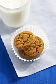 Ginger Snaps in a Paper Cup with a Glass of Milk