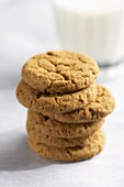 A Stack of Ginger Snaps with a Glass of Milk