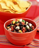 Bowl of Toasted Corn and Black Bean Salsa with Crumbled Queso Fresco