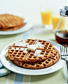 Plate of Waffles with Butter and Maple Syrup
