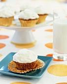 Carrot Cake Cupcake on a Plate with Foil Cup Peeled Back