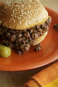 Sloppy Joe on a Sesame Seed Bun with Pickle
