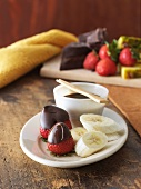 Chocolate Dipping Sauce with Dipped Strawberries and Bananas