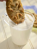 Dunking a Peanut Butter Cookie into a Glass of Milk