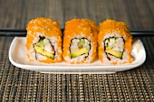 Three California rolls with caviar