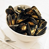 Belgium Mussels in White Wine in a Bowl; Fork