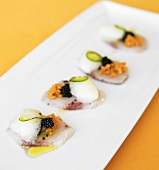 Kampachi Sashimi with Fruit, Caviar and Jalapeno on a Platter