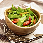 Snap Pea Salad with Red and Yellow Bell Peppers; Wooden Bowl