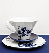 Tea Cup with Floral Design on Two Plates