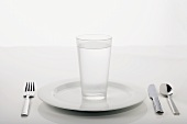 Place Setting with a Glass of Water on Dinner Plate