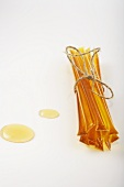 Bundle of Honey Sticks with Two Drips of Honey on White
