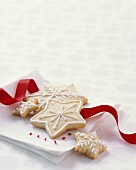 Decorated Christmas Cookies on a Napkin with Ribbon