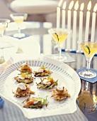 Potato Latkes on Serving Plate; Cocktails