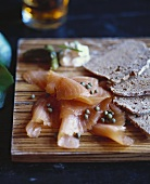 Smoked Salmon with Capers and Bread on Board