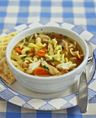 Bowl of Chicken Noodle Soup with Crackers