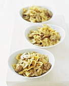 Three Bowls of Farfalle with Mushrooms and Garlic