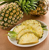 Fresh Pineapple Slices on a Plate, Whole Pineapple