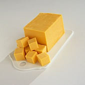 Block of Yellow American Cheese with Cubes
