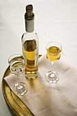 Bottle of Sauternes with Two Glass; One Full; One Empty